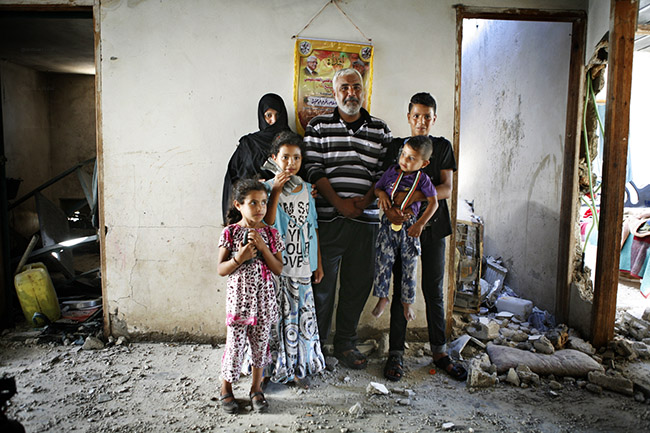 The Abu Hashis family with four of their six children. Umm Al Nasser, Gaza 2-8-2014