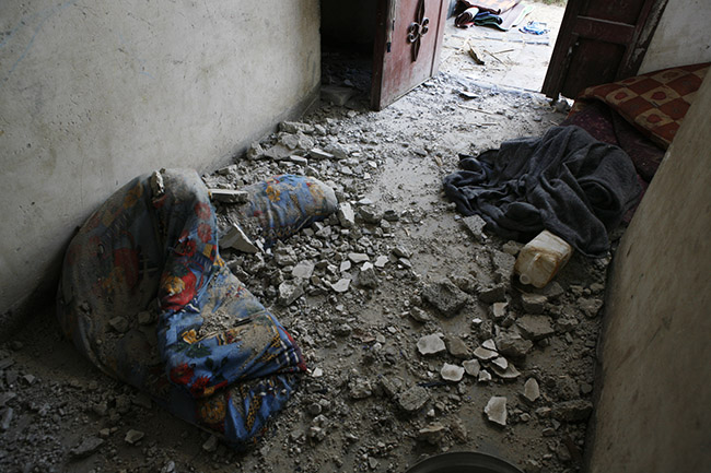 Rubble in the Abu Hashis home. Umm Al Nasser, Gaza 2-8-2014