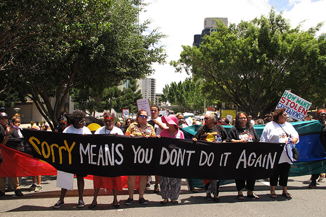 Aboriginal and Torres Strait Islander activists march through the Brisbane business district in the running up to the G20 to protest governmental indigenous policies. Brisbane, Australia 10/11/14