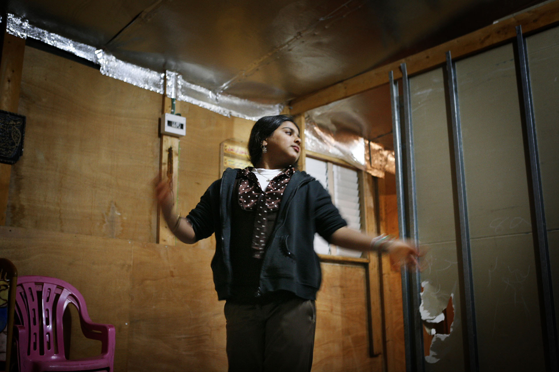 Fatima Abu Madegham Al Turi dances in her home. Al Araqib, February 2010
