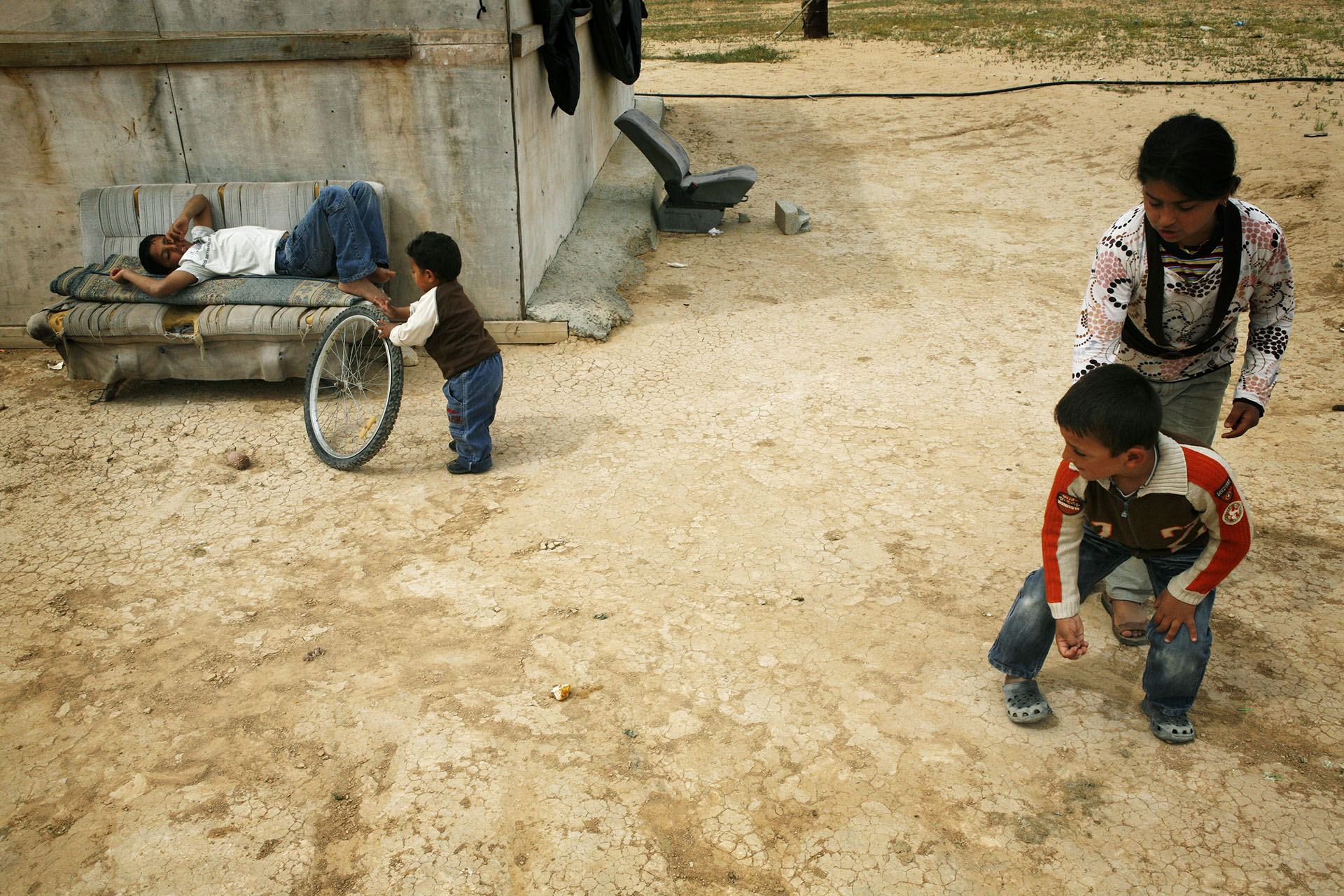 Azeez's children play with marbles outside their home. Al Araqib April, 2009