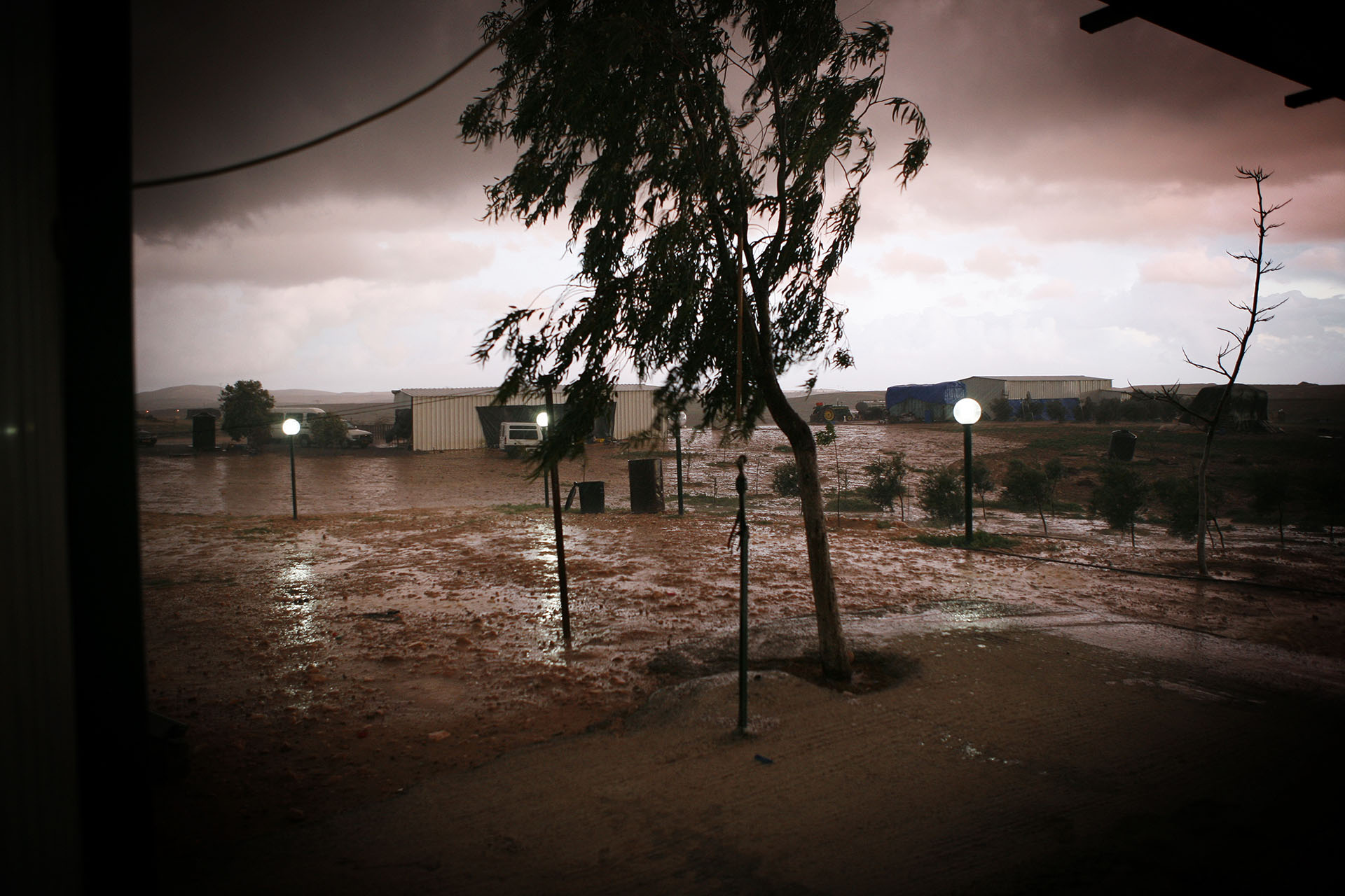 Al Araqib during a storm. Lamps powered by solar energy mark the paths leading to different homes. February 2010