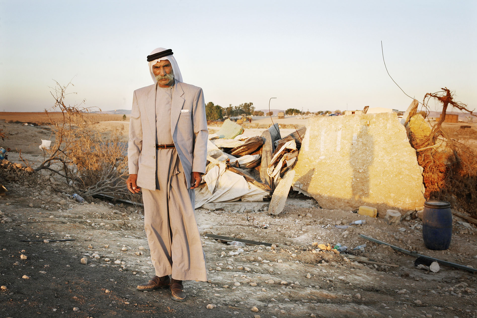 Sheikh Sayah Al Turi stands by the ruins of his home. September 2010