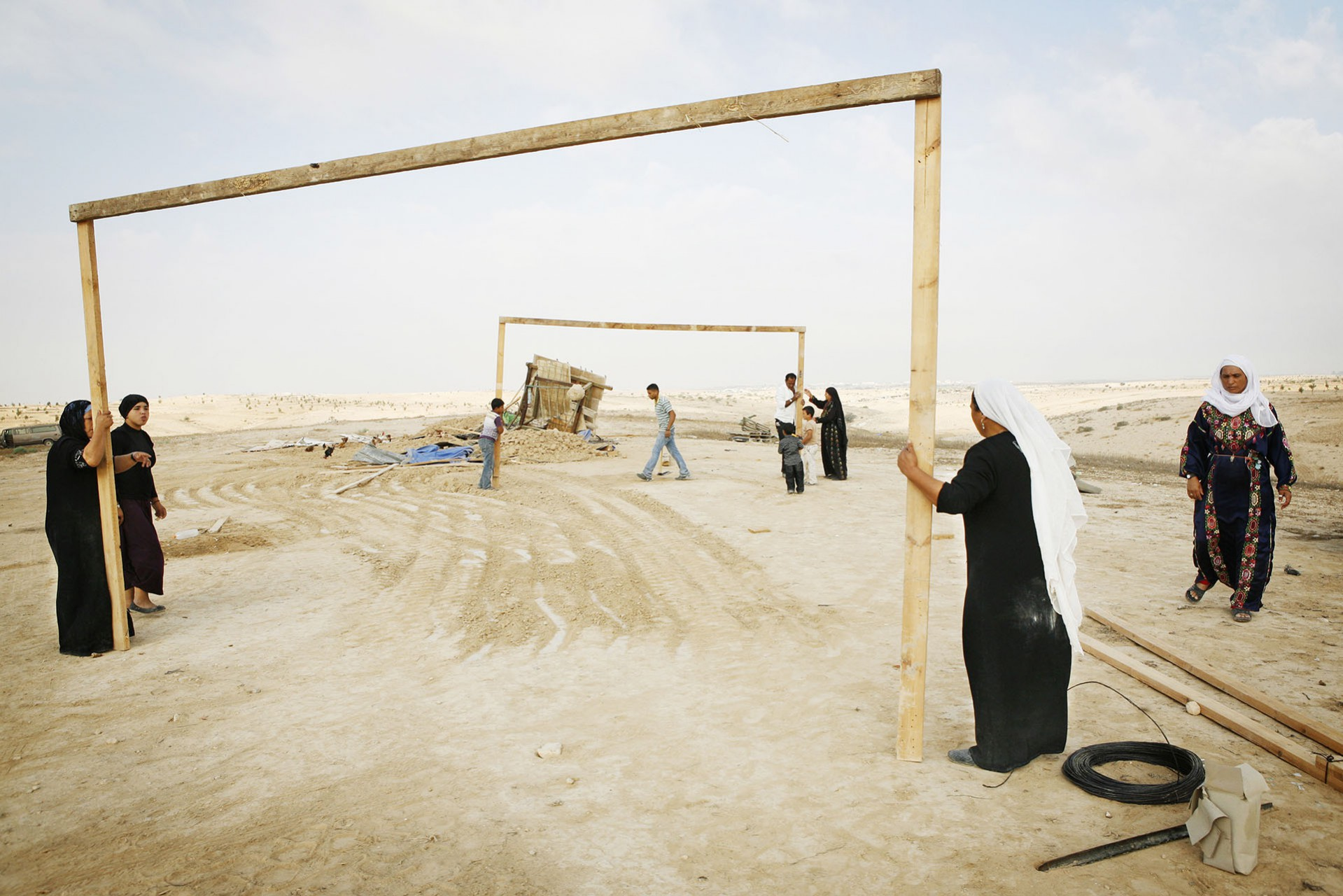 Women and men begin reconstructing the village after another demolition. Al Araqib, September 2010