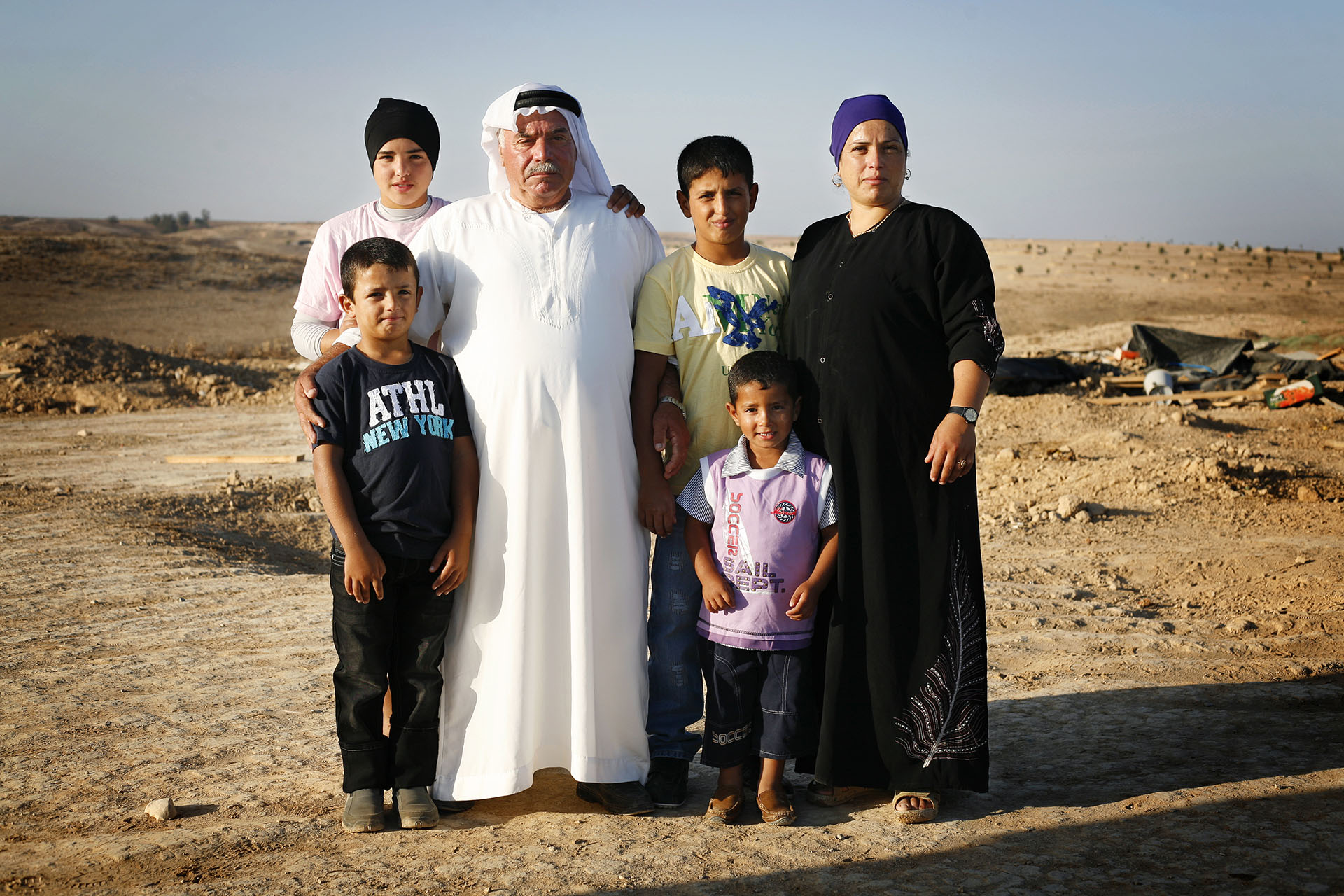 Sabah and her kids stand with their grandfather on the holiday of Eid Al Fitr which marks the end of the holy month of Ramadan. September 2010