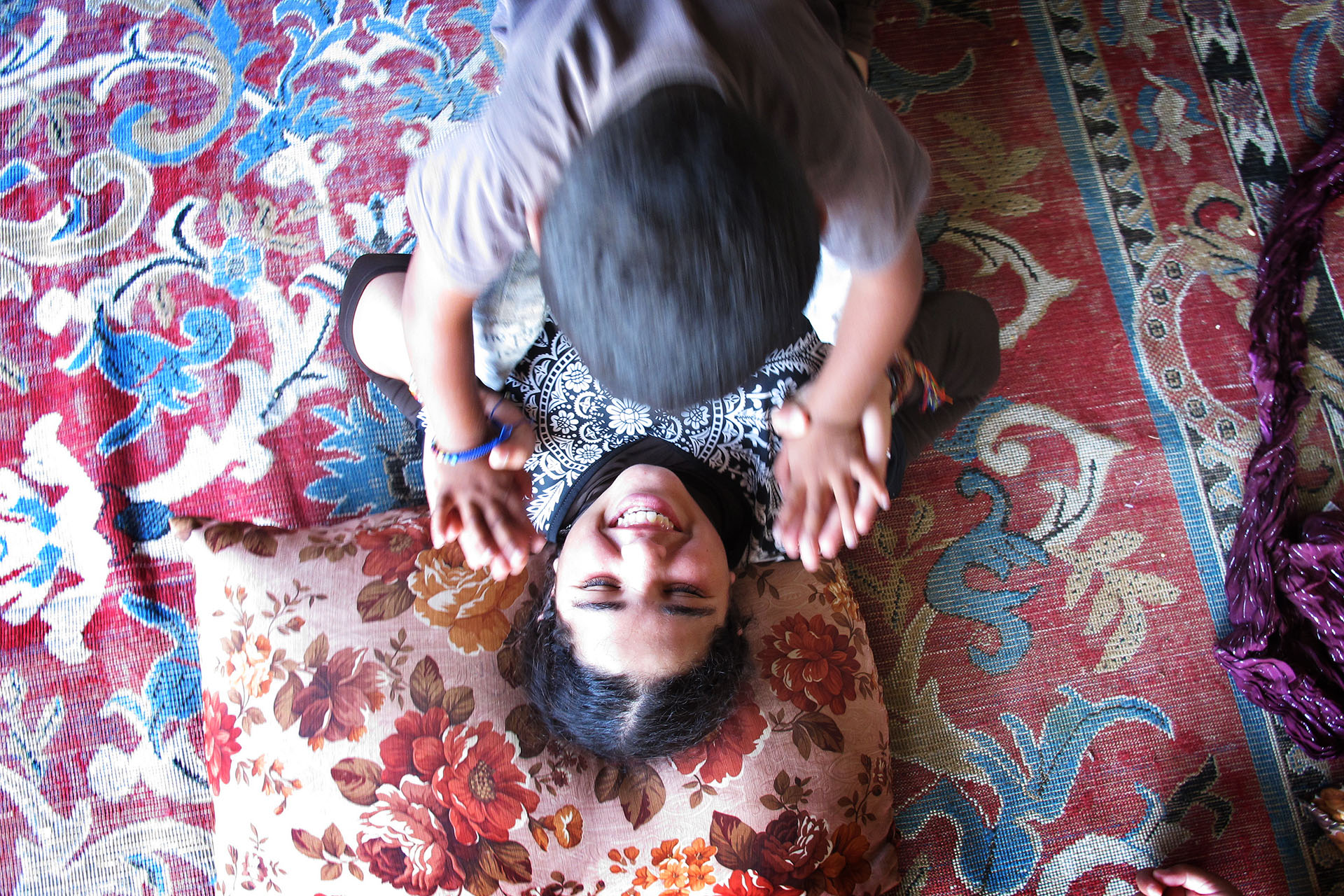 Hala and Mohammed play in the structure they now call home. July 2011