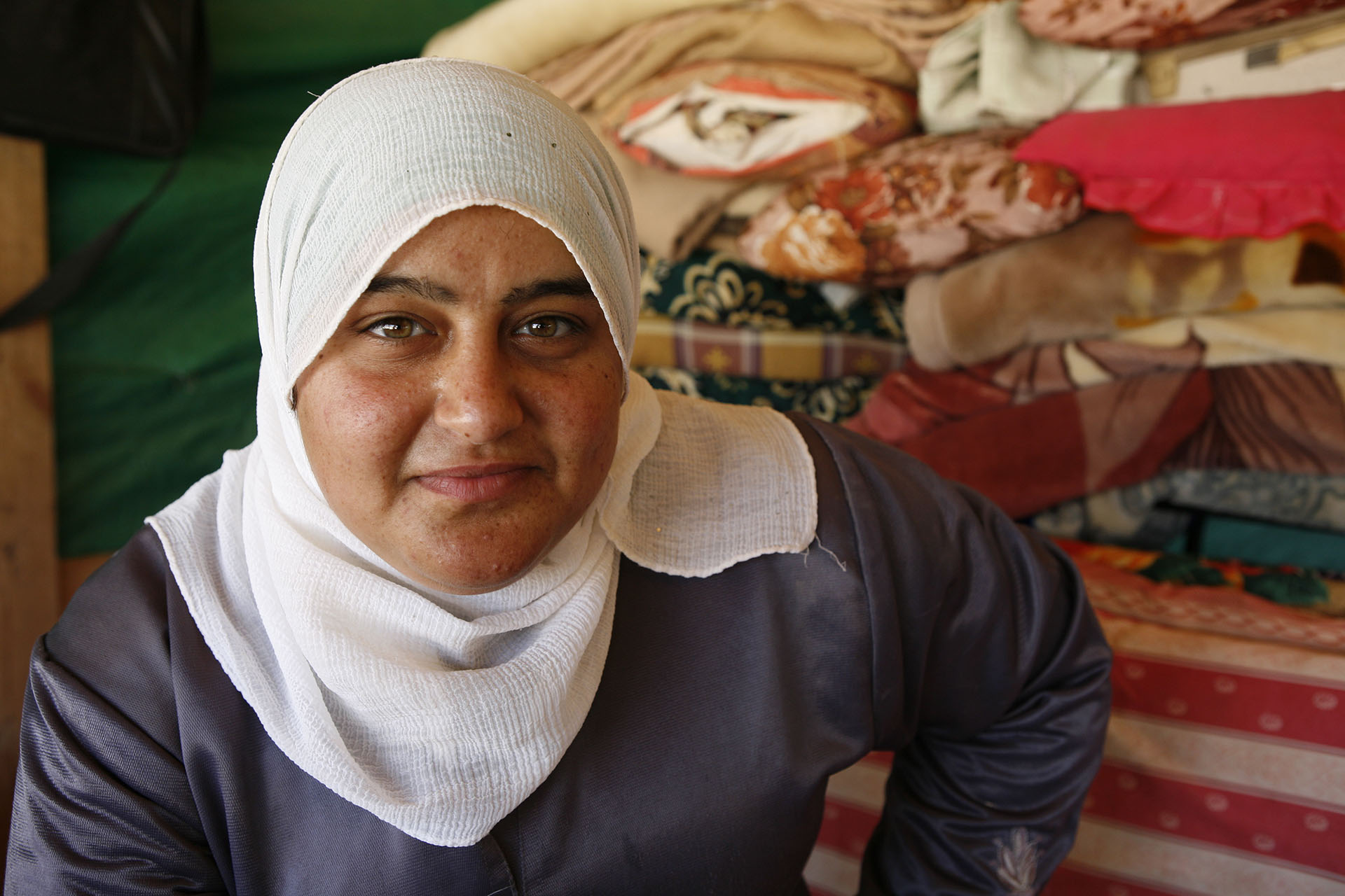 Mariam, Sujoud's sister, sits in the bedroom of the home built following the first demolition of July 2010. Al Araqib July 2012