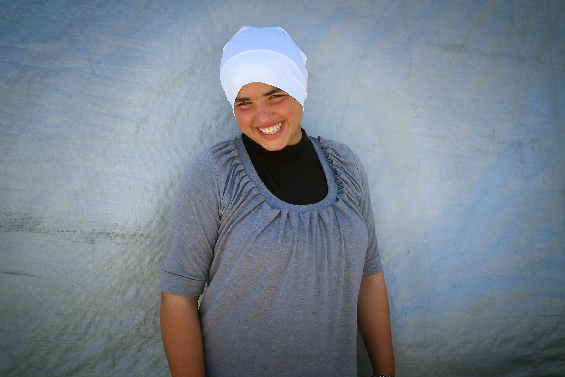 Hala poses for a photo outside her home. Al Araqib July 2010
