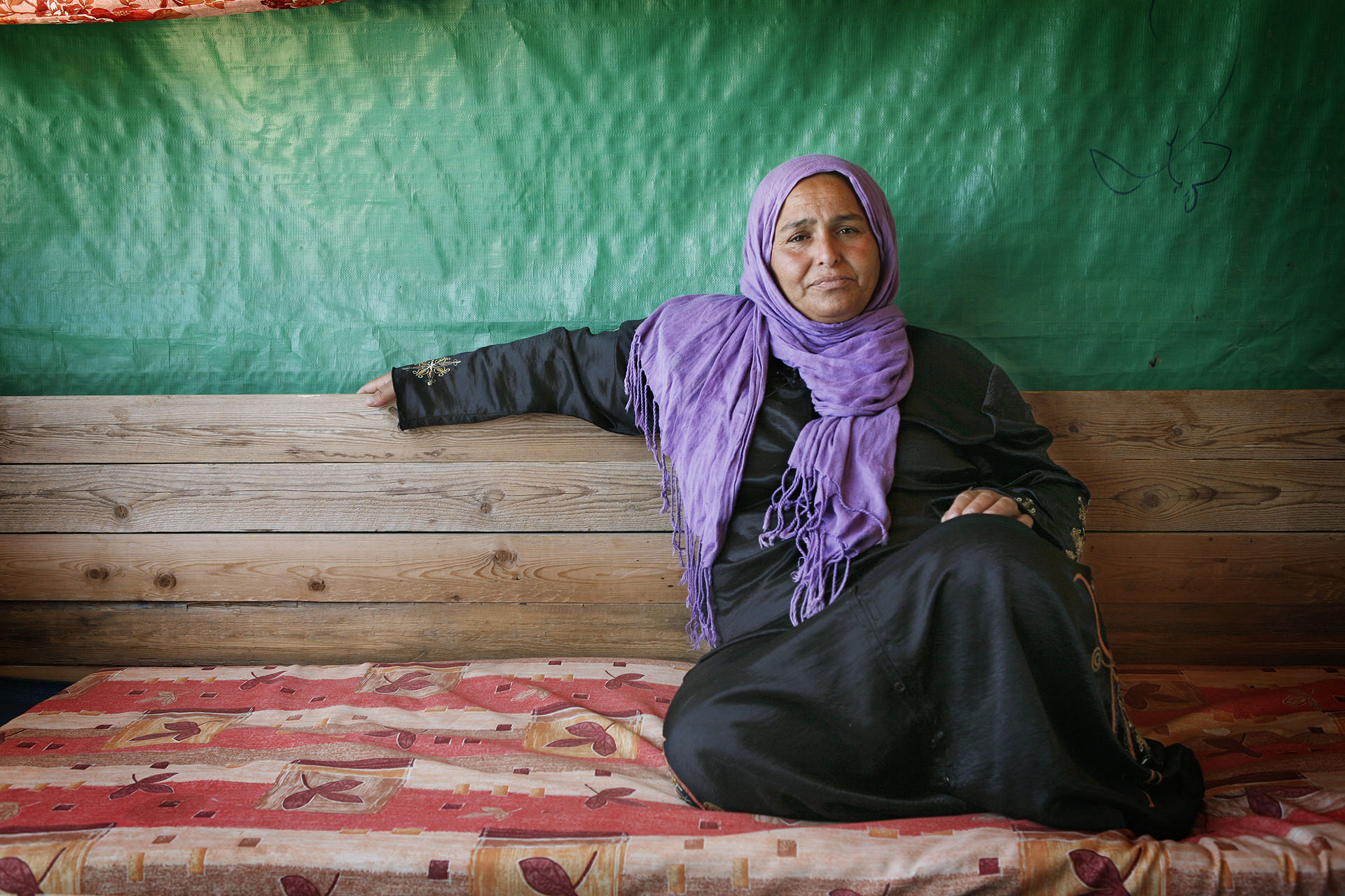 Haqima, in the home she built with her husband and children following the 2010 demolition. Al Araqib July 2012