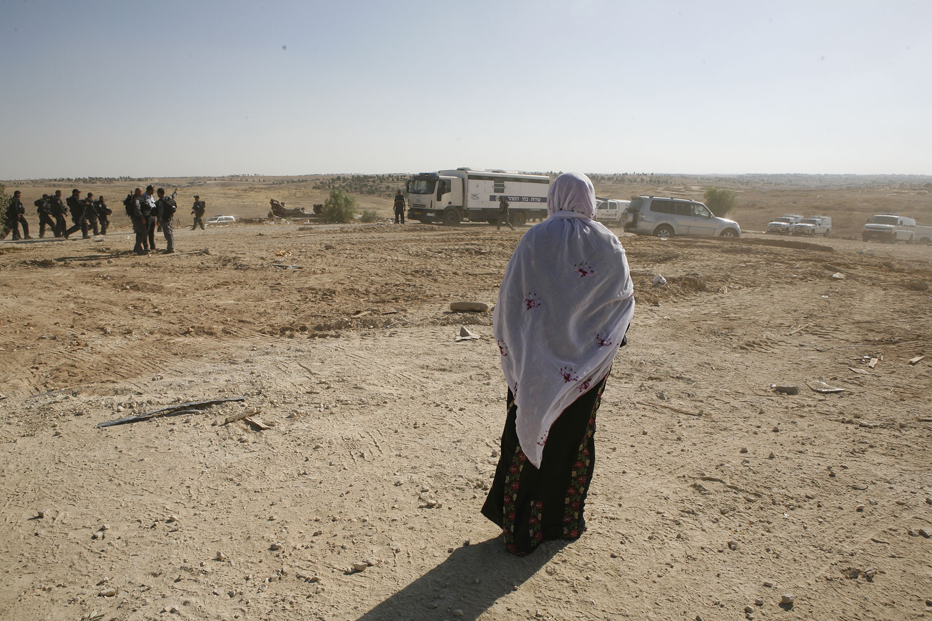 On 12 June 2014, the state of Israel attempted once again to completely shut down Al Araqib. Between July 2010 and June 2014, the state had demolished homes built outside the cemetery perimeter. Families had resettled inside the perimeter but continued to build symbolic structures outside too, where their homes once stood.  On June 12, police entered the perimeter and razed everything to the ground. Al Araqib, June 2012