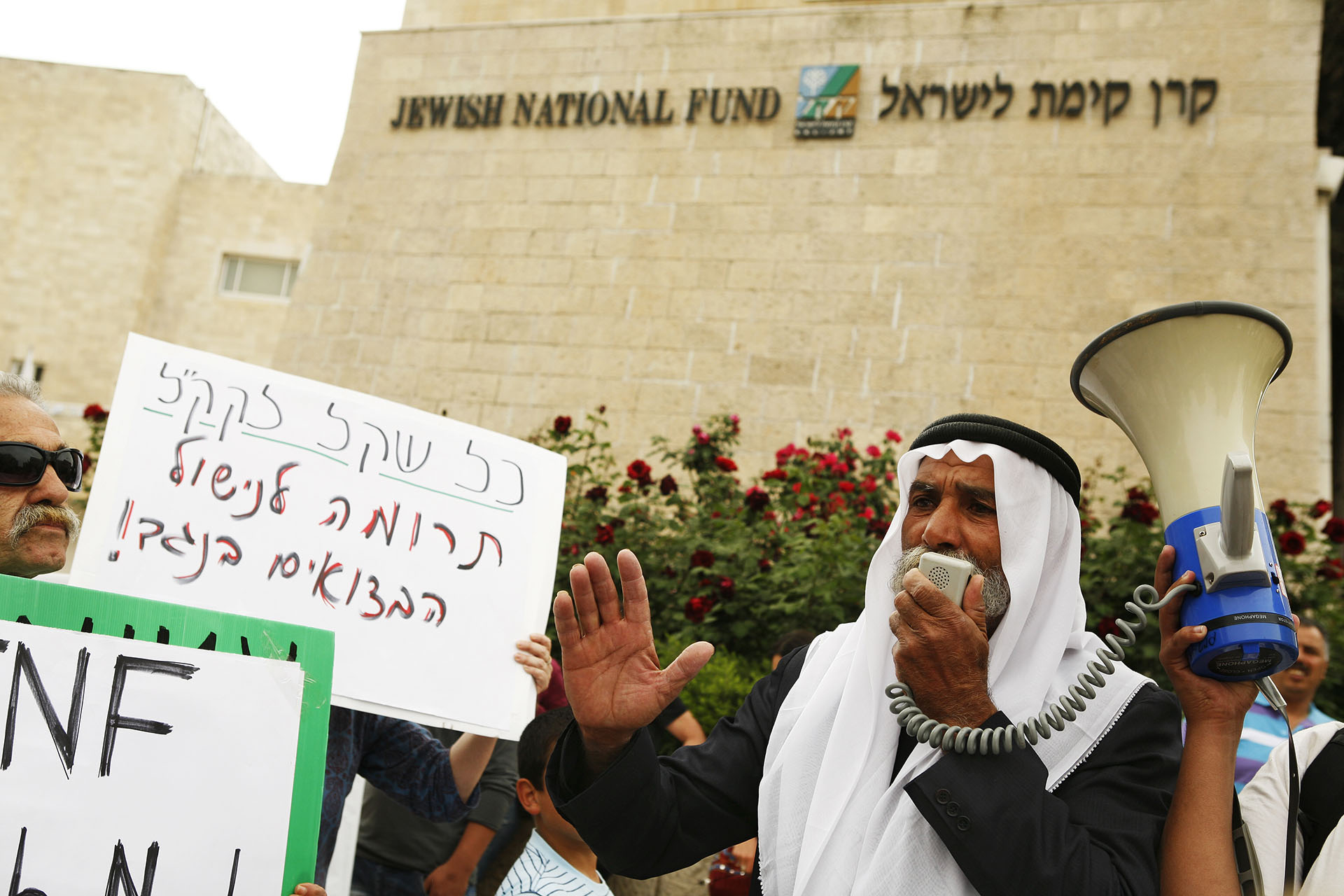 Outside the headquarters of the JNF, Sheikh Sayah protests the demolition of his village. The JNF and the state are plating a forest where the homes of the Al Turi stood. Jerusalem, April 2012