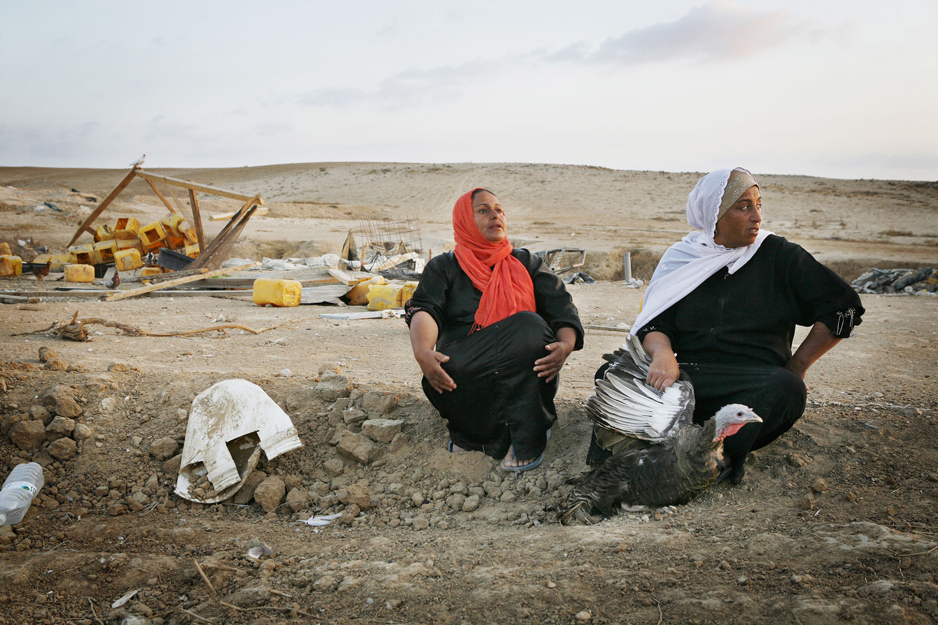 Women sit in the village after the umpteenth demolition. Al Araqib, September 2010