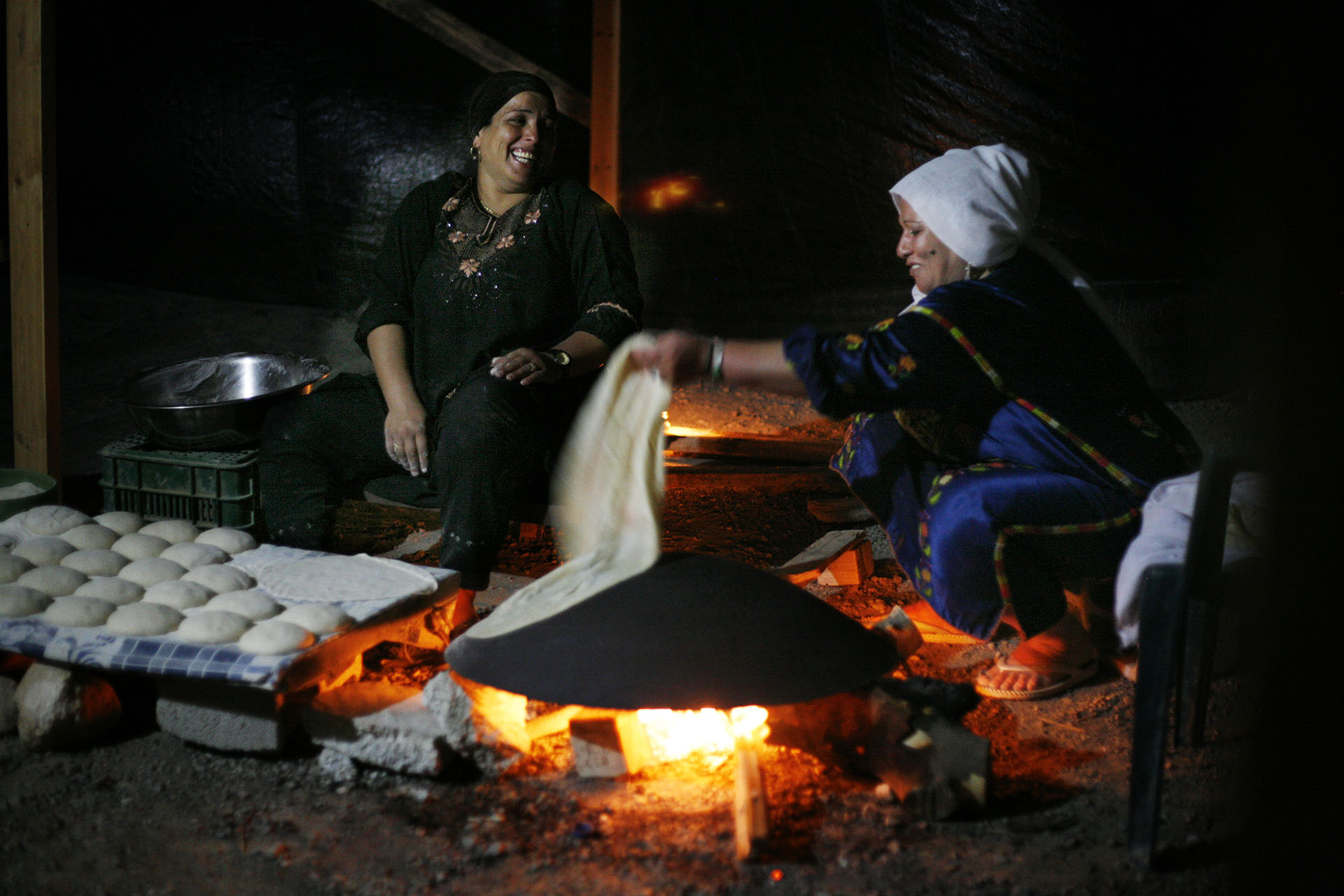 Sabah and Alia bake bread. Al Araqib, September 2010