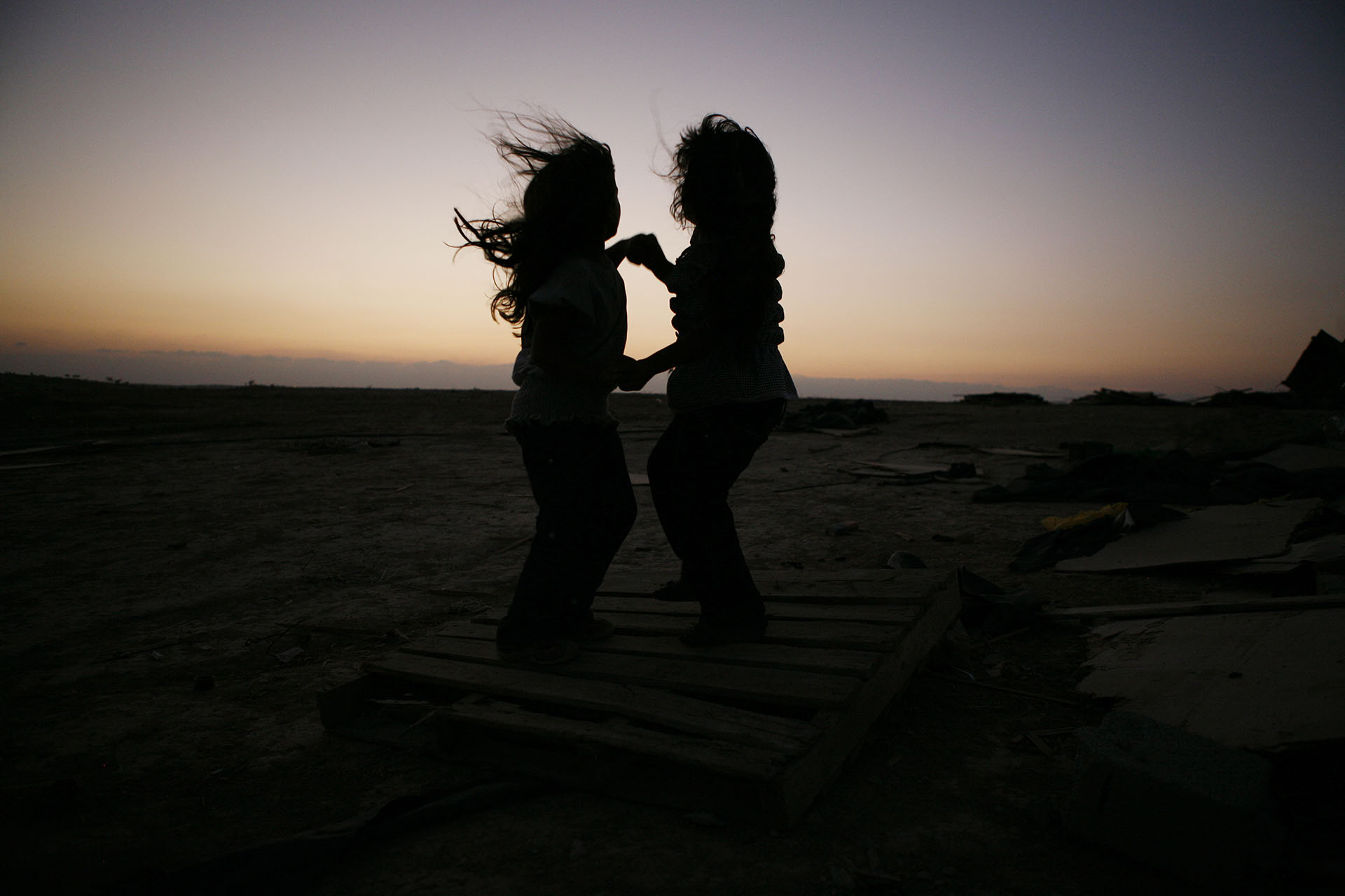 Girls dance against the sunset in Al Araqib. September 2010