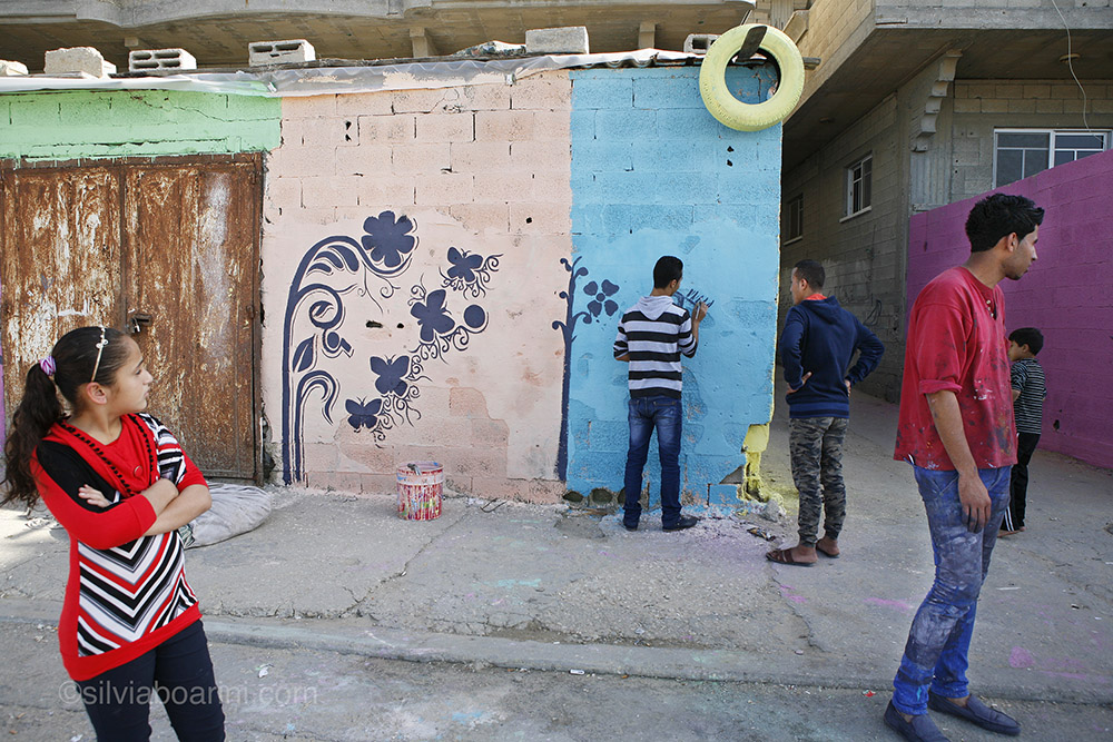 Al Shati refugee camp, Gaza is given a make-over by Palestinian artists and inhabitants. The project was sponsored by the Palestinian share-holding company PADICO. Shati, Gaza