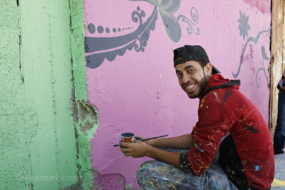 Artist Jehad Naiem Abaas, 25, from Bet Lahia, takes part in the Al Shati refugee camp make-over sponsored by the Palestinian share-holding company PADICO. Shati, Gaza