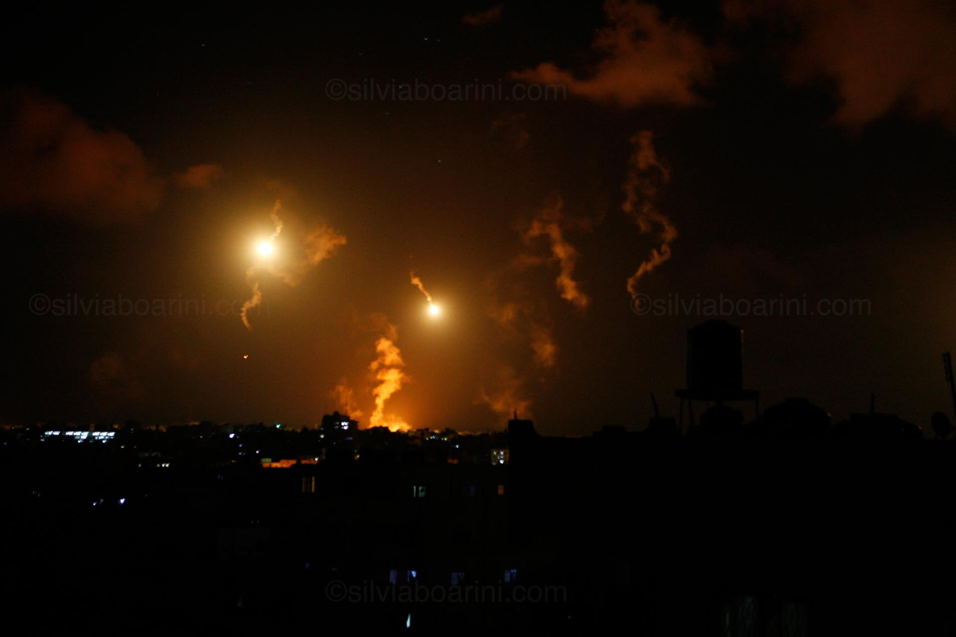 Flares light up the night sky in Shujayea. Gaza July 2014