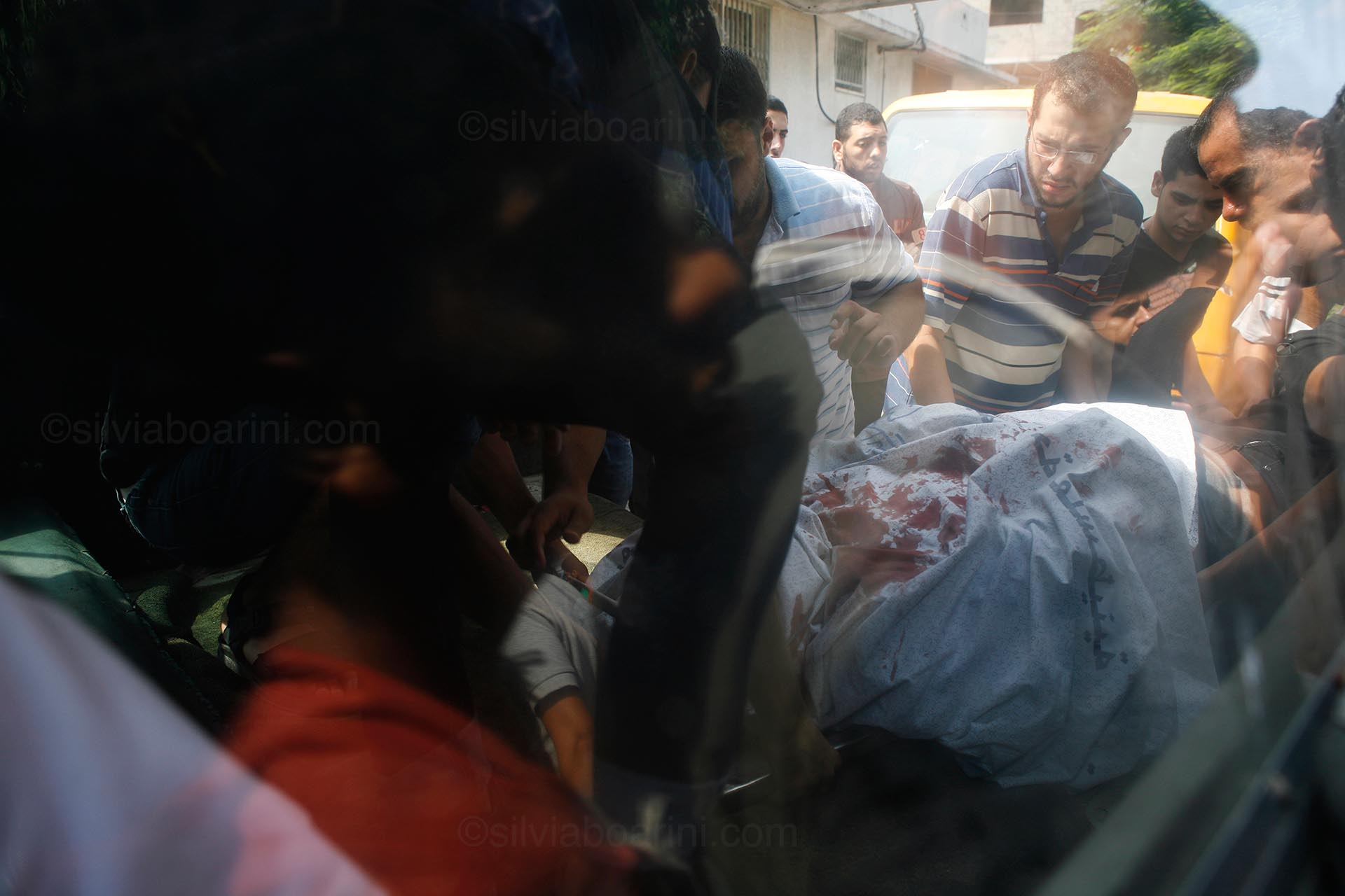 An ambulance arrives at the Shifa hospital morgue on the day Israeli forces began carpet bombing the neighbourhood of Shujaya. Gaza, 20 July 2014