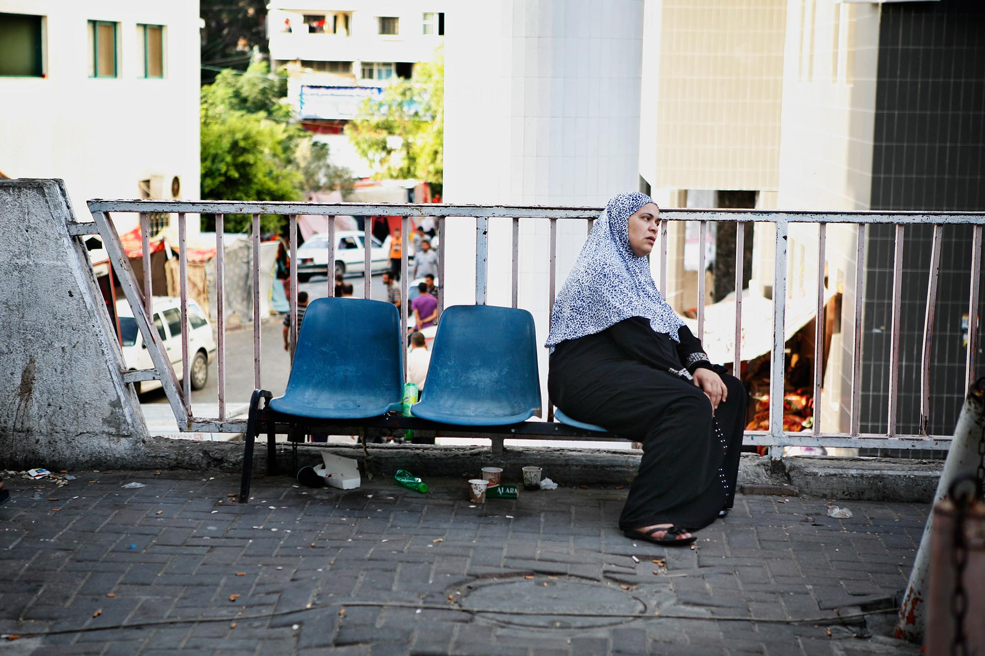 A woman sits outside Shifa hospital. Gaza, July 2014