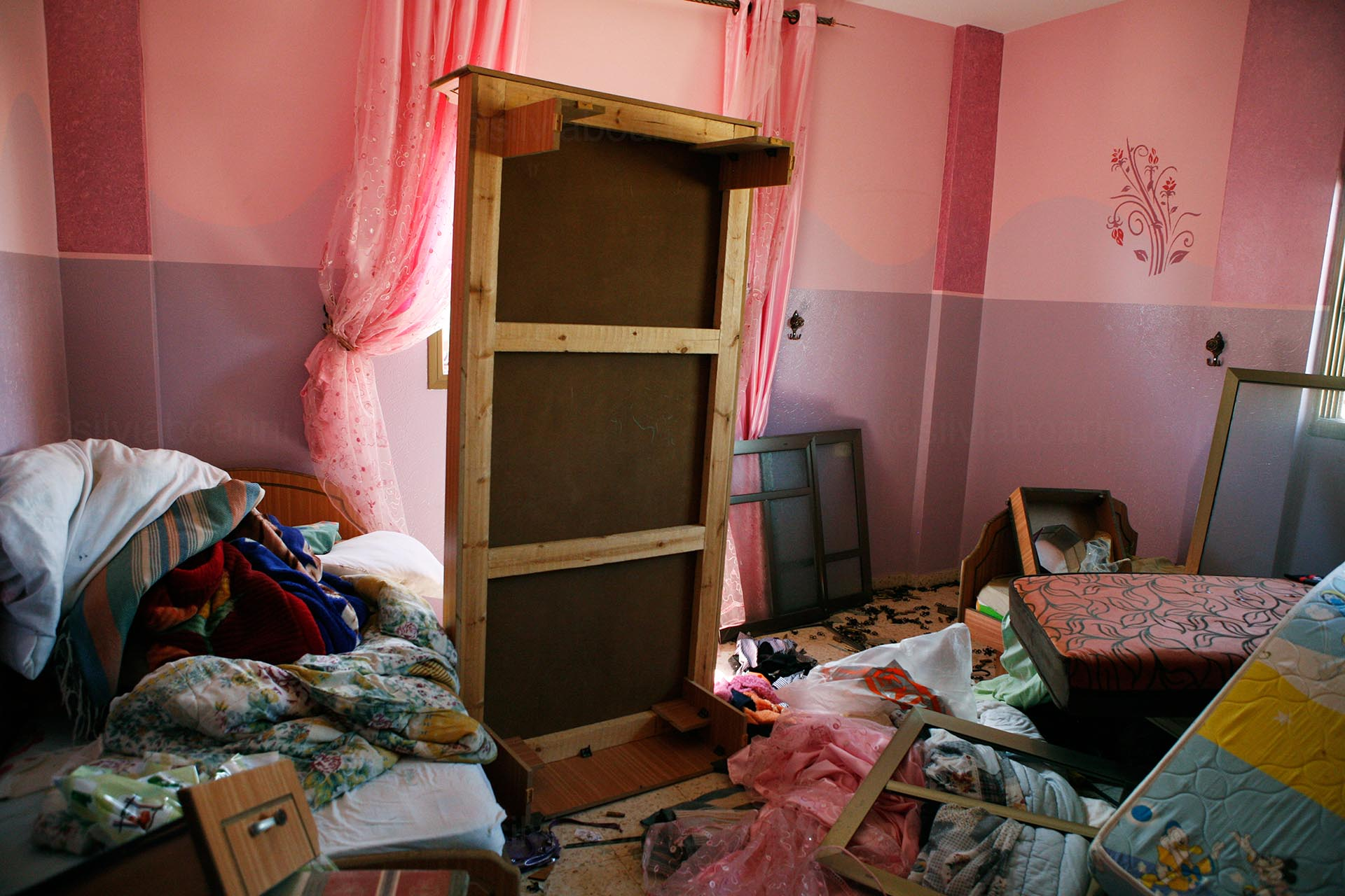 A child's bedroom in one of the homes in Khouza which were taken over by the Israeli army during the ground operation along the eastern border. August 2014