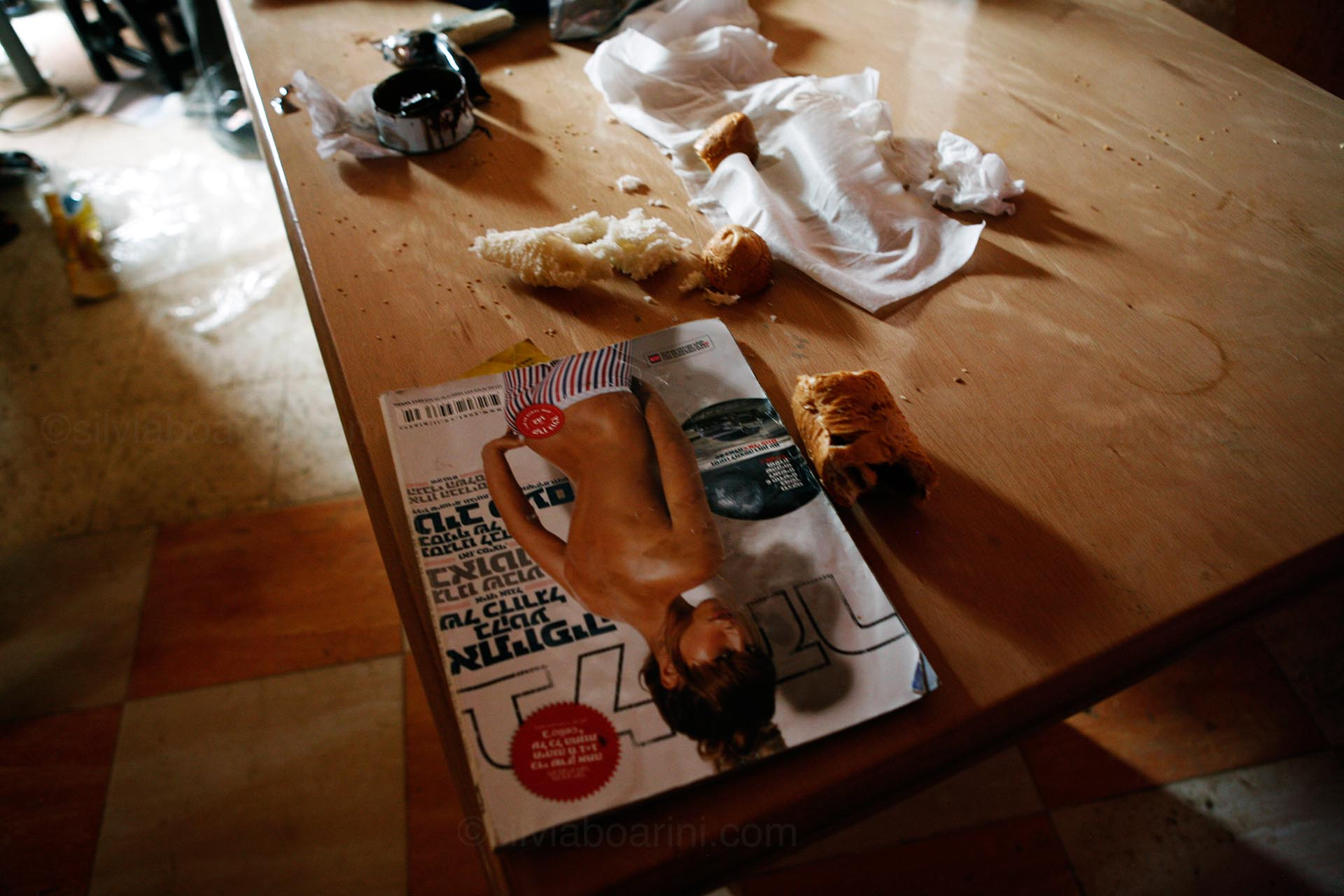 A Hebrew magazine in one of the homes in Khouza which were taken over by the Israeli army during the ground operation along the eastern border. August 2014