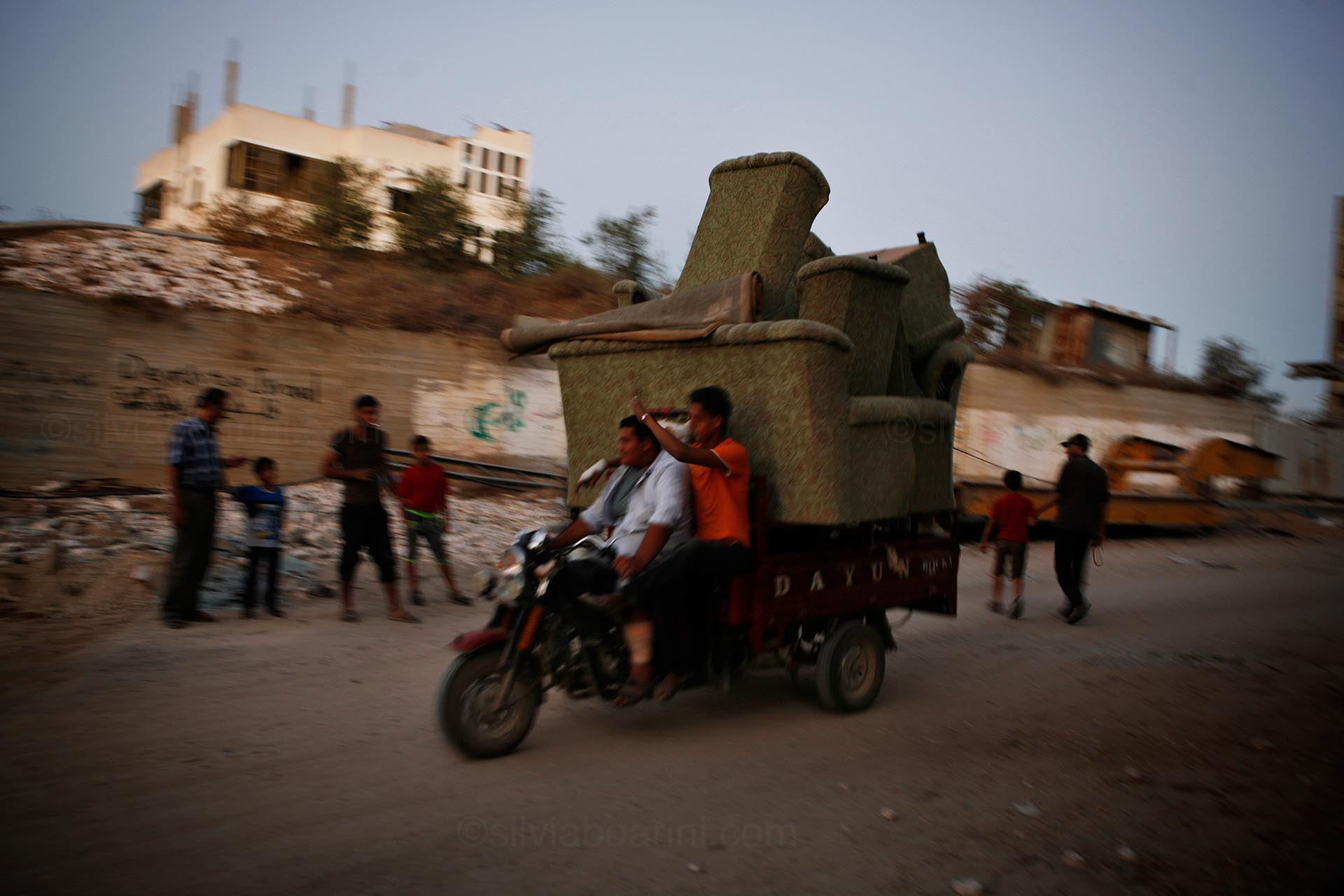 Shujayea, people recover belongings from the rubble of their homes. August 2014